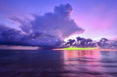 Sunset and storm front with rain over the sea Stock Photography