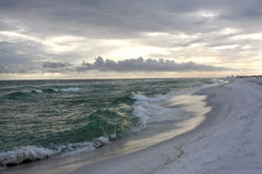 Sunset on a Stormy White Sand Beach Stock Photos
