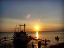 Sunset and Strangers. Carabao island beach sunset Royalty Free Stock Photo