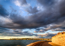 Sunset on the streets of Porec. Sunset on the Mediterranean sea with a cloudy background near Porec in Croatia Royalty Free Stock Photography