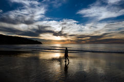 Sunset Stroll. Strolling on the beach at sunset Royalty Free Stock Photo