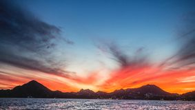 Sunset with a stunning beautiful sky above the city of Cabo San Lucas. Mexico. Sea of Cortez. Stock Images
