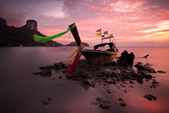 Sunset summer boat thai and landscape in the mountain and sea ,. Krabi , Thailand stock image