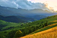 Sunset in the summer mountain valley with the beautiful rays of the sun. Natural summer landscape stock images