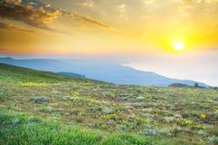 Sunset in summer mountains. Stock Photos