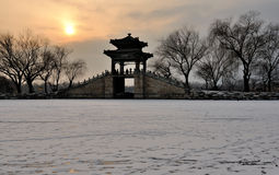 Sunset of the Summer Palace. It is the sunset of the Summer Palace in winter and Kunming Lake is completely frozen Royalty Free Stock Images