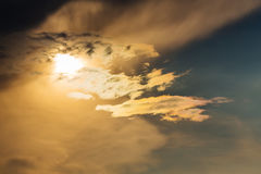 Sunset with sun clouds over clouds Stock Photos