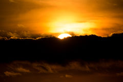 Sunset with sun clouds over clouds Stock Images