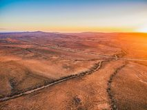Alien landscape of Flinders Ranges. Sunset sun flare over alien landscape of Flinders Ranges in South Australia royalty free stock photography