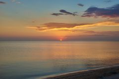 Sunset. Red sun leaving the horizon of the sea. Sunset. The sun that goes beyond the horizon of the sea stock photography