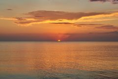 Sunset. Red sun leaving the horizon of the sea. Sunset. The sun that goes beyond the horizon of the sea royalty free stock photography