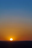 Sunset with sun at orizont with blue and red sky.  stock image