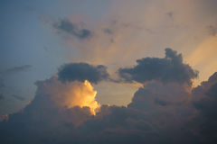 Sunset with sun rays and big cloud background. Sunset with sun rays and  big cloud background Royalty Free Stock Image