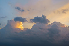 Sunset with sun rays and big cloud background Stock Image