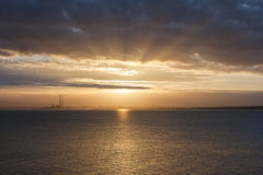 Sunset with sun rays Stock Photo
