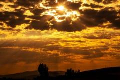 Sunset with sun rays stock photo