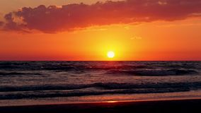 Sunset of sun setting over pacific ocean on windy evening. stock video footage