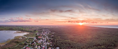 Sunset. Sun setting over a small seaside village Kąty Rybackie, Poland Stock Images