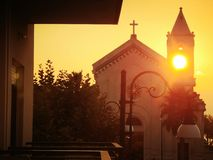 Sunset through a church belltower royalty free stock photography
