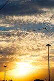 Sunset sun   in the sky of  streetlamp Stock Images