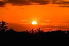 Sunset. The sun was falling by a cloud blocking the sun out royalty free stock photos