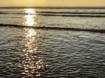 Sunset over the Atlantic Ocean from sand beach in Agadir, Morocco, Africa royalty free stock image