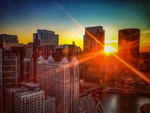 Sunset sunbeams seen from up high over Chicago cityscape royalty free stock photos