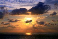 Sunset and Sunbeams through Tropical Clouds Formation over Acapulco Bay stock image