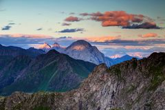 Sharp peaks at sunset in Carnic Alps main ridge and Julian Alps. Sunset sunlight stripes on jagged peaks of Chianevate Kellerspitzen Coglians Hohe Warte Peralba Royalty Free Stock Photography