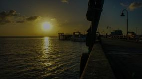 Sunset. A sunny be under water and moon came instantly royalty free stock image