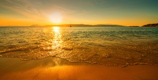 Sunset sunny beach. Sunny beach at sunset with boat stock images