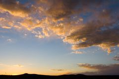 Sunset or sunrise. Sunset with hills Royalty Free Stock Images