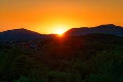 Sunset sunrise behind the mountain Stock Image