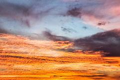 Sunset / sunrise with clouds and light effect Stock Images