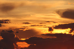 Sunset / sunrise with clouds, light rays Royalty Free Stock Image