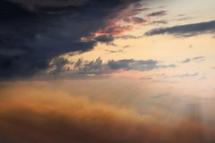 Sunset or sunrise with clouds, light rays and other atmospheric effect . Light in dark sky . Light from sky . beautiful cloud . Religion background  .  Road to Royalty Free Stock Image