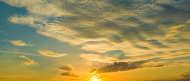 Sunset sunrise with clouds, light rays and other atmospheric effect, selective White balance. Stock Image