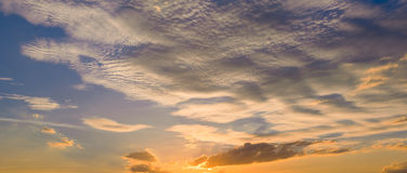 Sunset sunrise with clouds, light rays and other atmospheric effect, selective White balance. Stock Photo