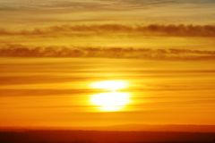 The sunset or sunrise. The cloudy sky cloured in red, orange, rose, scarlet, crimson, purple, violet and blue bright and vivid col. Oures with setting or rising royalty free stock photography