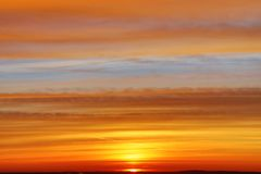 The sunset or sunrise. The cloudy sky cloured in red, orange, rose, scarlet, crimson, purple, violet and blue bright and vivid col. Oures with setting or rising royalty free stock photos