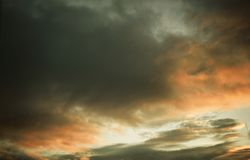 Sunset sunrise cloudy sky in gray and orange coloring. Like mystic, mystical, dramatic, poetic, magic, magical, occult background stock photos