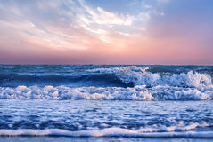 Sunset or sunrise colors over the ocean or sea Stock Photo