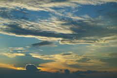 Sunset and sunrise with dramatic sky over ocean royalty free stock photography