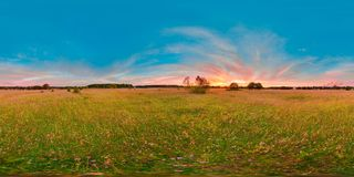 Sunset or sunrise in the green field with blue sky with pink color. 3D spherical panorama with 360 viewing angle. Ready for virtua. L reality or VR. Full Royalty Free Stock Photo