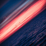 Sunset or Sunrise Horizon Abstract. Beautiful Fiery Red Pink Sunset or Sunrise Horizon over Blue Ocean Sea Lake Water. Diagonal Square Layout Nature Background Stock Photo