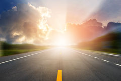 Sunset or sunrise light above asphalt road. Landscape of sunset or sunrise light above asphalt road royalty free stock photography