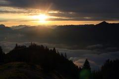 Sunset/sunrise in the mountains. Sunset/sunrise in mountains of the alps. Mountains appear as silhuettes because of the light setting Stock Image