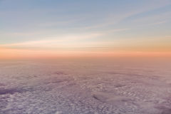 Sunset or sunrise over clouds Stock Photo