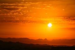 Sunset Sunrise Over Dark Mountain Silhouette. Yellow And Orange. Colors Of Sunrise. Sunshine Dramatic Sky Stock Images