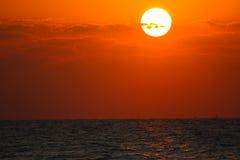 Sunset or Sunrise over the Ocean. Bright orange sunset or sunrise over the ocean Royalty Free Stock Photography